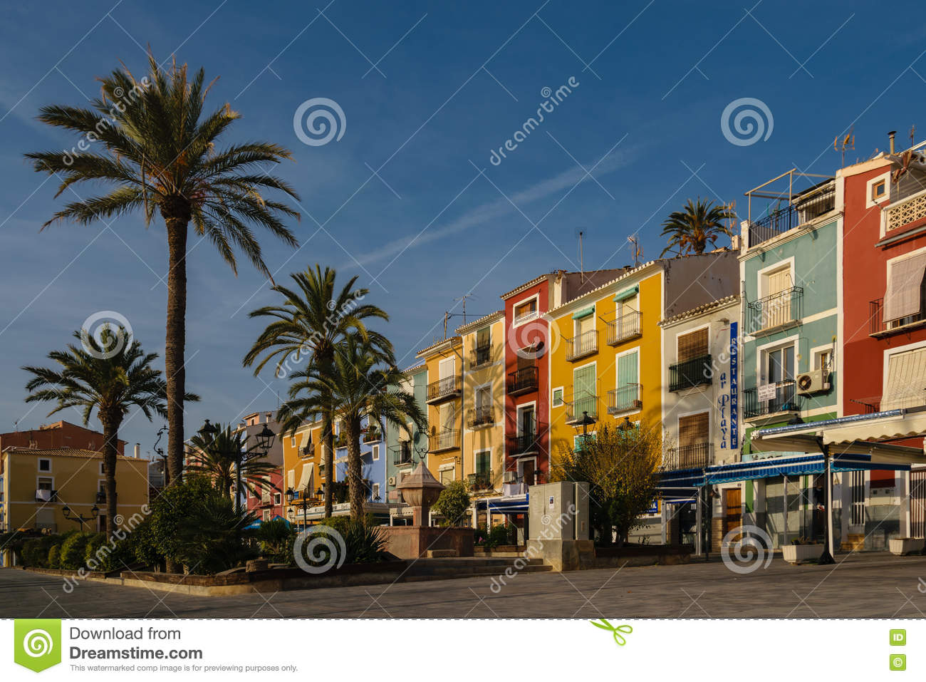 Villajoyosa Multicolored Houses And Palms, Spain Editorial Image.