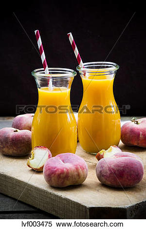 Stock Image of Peach smoothie and vineyard peaches lvf003475.