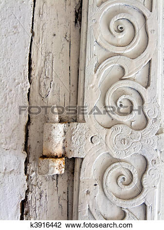 Stock Photo of An old door hinge of a House k3916442.
