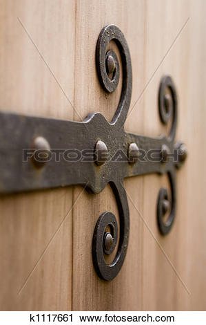 Stock Photography of Old door hinge on a rusti k1117661.