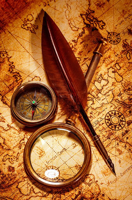 Vintage magnifying glass lies on an ancient world map in.
