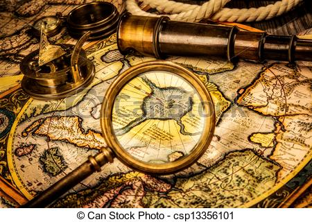 Vintage magnifying glass, compass, telescope lies on the ancient map of the  North Pole (also Hyperborea). Arctic continent on the Gerardus Mercator.