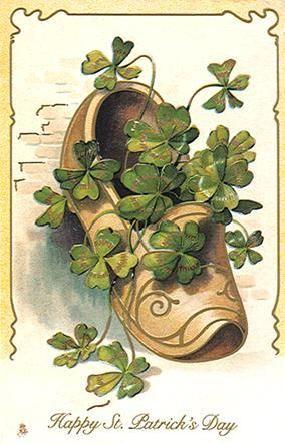 Happy St. Patrick\'s Day. Clog full of shamrocks..
