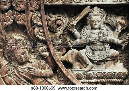 Stock Photograph of Wooden carving of the God at Vishnu temple.