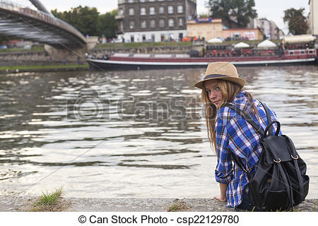 Pictures of Young nice girl sits on the bank of Vistula River in.