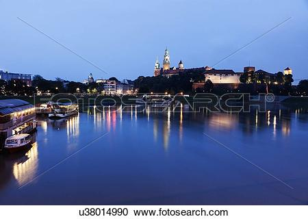Stock Photography of Wawel Royal Castle and Vistula River evening.
