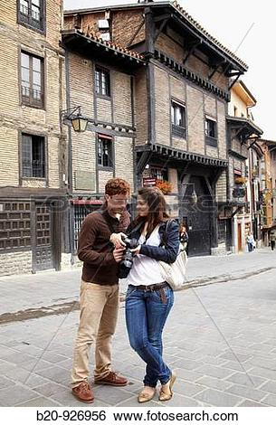 Stock Images of Young tourist couple. El Portal?n, Medieval town.