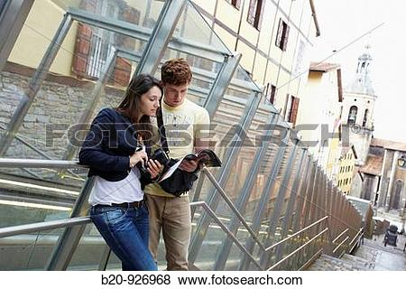Pictures of Young tourist couple. Escalator, Old town, San Pedro.