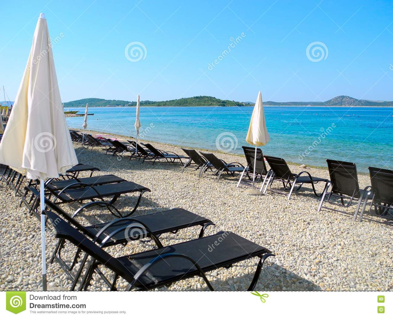 Sun Loungers On The Beach In Vodice. Stock Photo.