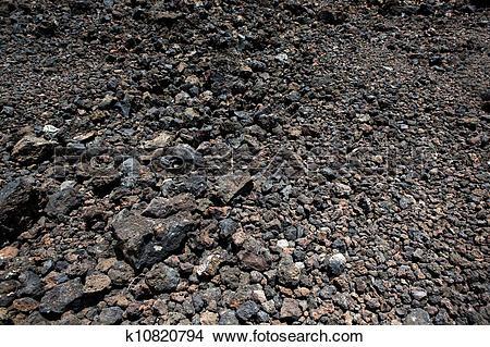 Stock Photo of Black volcanic stones soil texture k10820794.