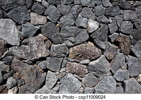 Stock Photo of Black lava stone volcanic masonry wall in Canary.
