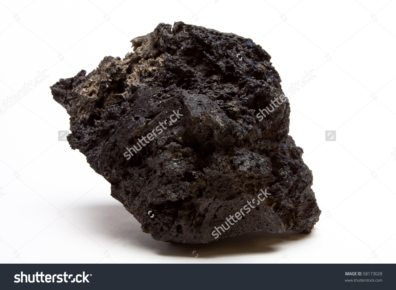 Abstract Chunk Of Lava Rock From Low Perspective Isolated Against.