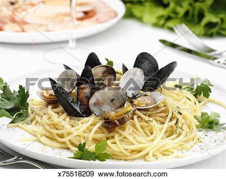 Stock Photograph of Italian cuisine. Spaghetti alle vongole.