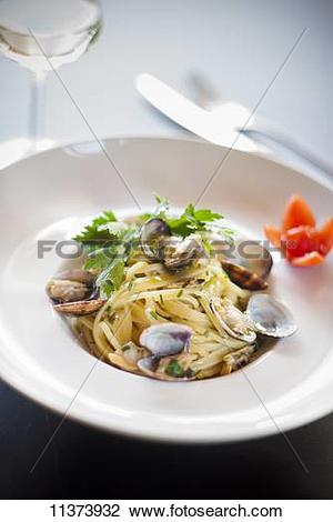 Stock Photo of Trenette con le vongole (pasta with clams, Italy.