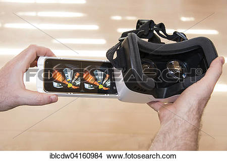 Stock Photo of Man holding ZEISS VR ONE virtual reality VR plastic.