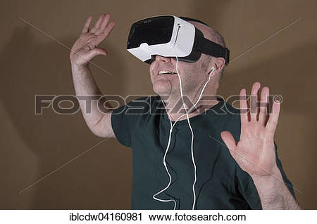Stock Photography of Man wearing ZEISS VR ONE virtual reality VR.