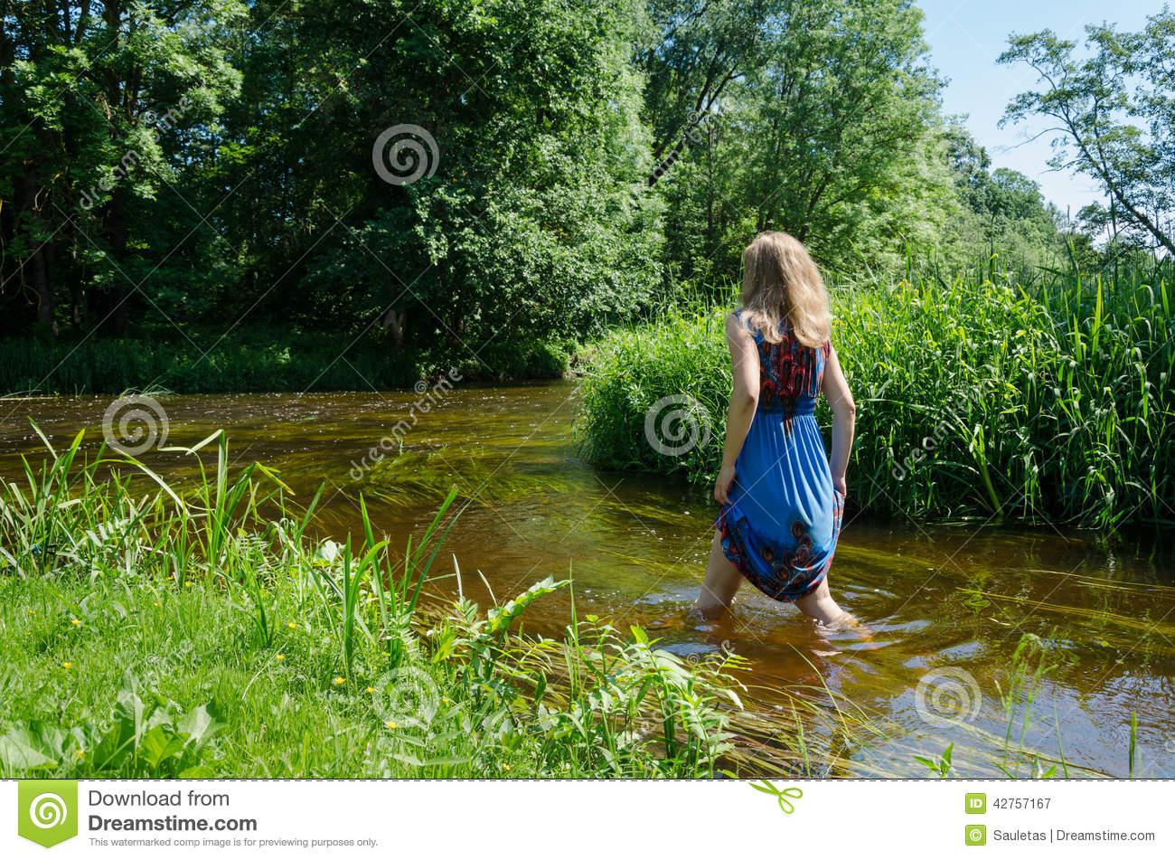 Blonde Girl Blue Mottled Dress Wade Flowing River Stock Photo.
