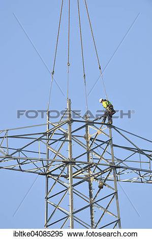 Stock Image of Overhead lineman working on a pylon, Waiblingen.