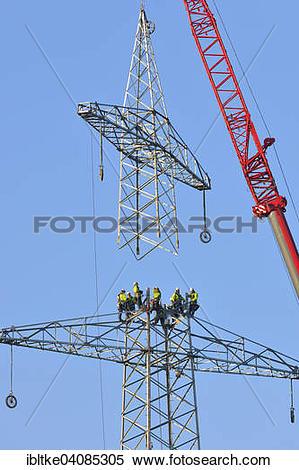 Stock Image of Overhead linemen working on a pylon, Waiblingen.