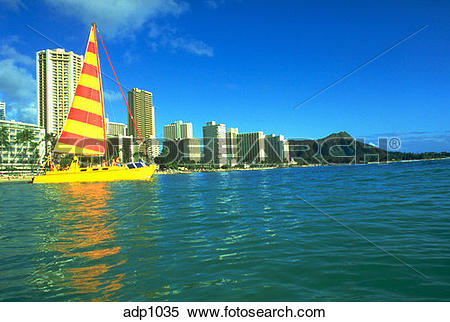 Stock Image of Sailboat and resort hotels on Waikiki Beach with.
