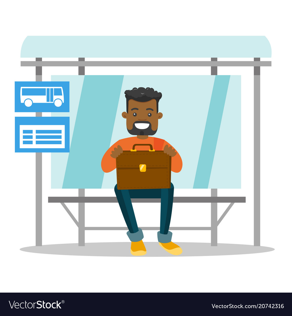 Black man waiting for a bus at the bus stop.