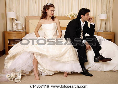 Stock Photograph of Bride waiting for groom to get off the phone.