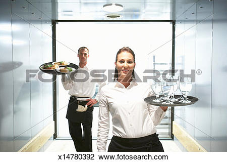 Stock Photo of Waiter and waitress holding food and drink on trays.