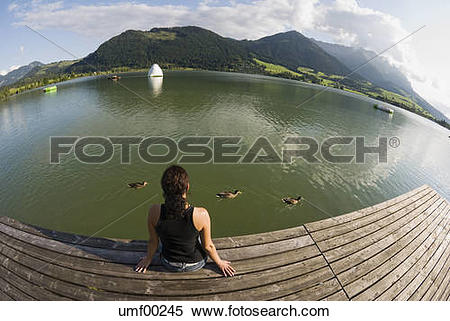 Stock Image of Austria, Tyrol, Walchsee, Woman relaxing on the.