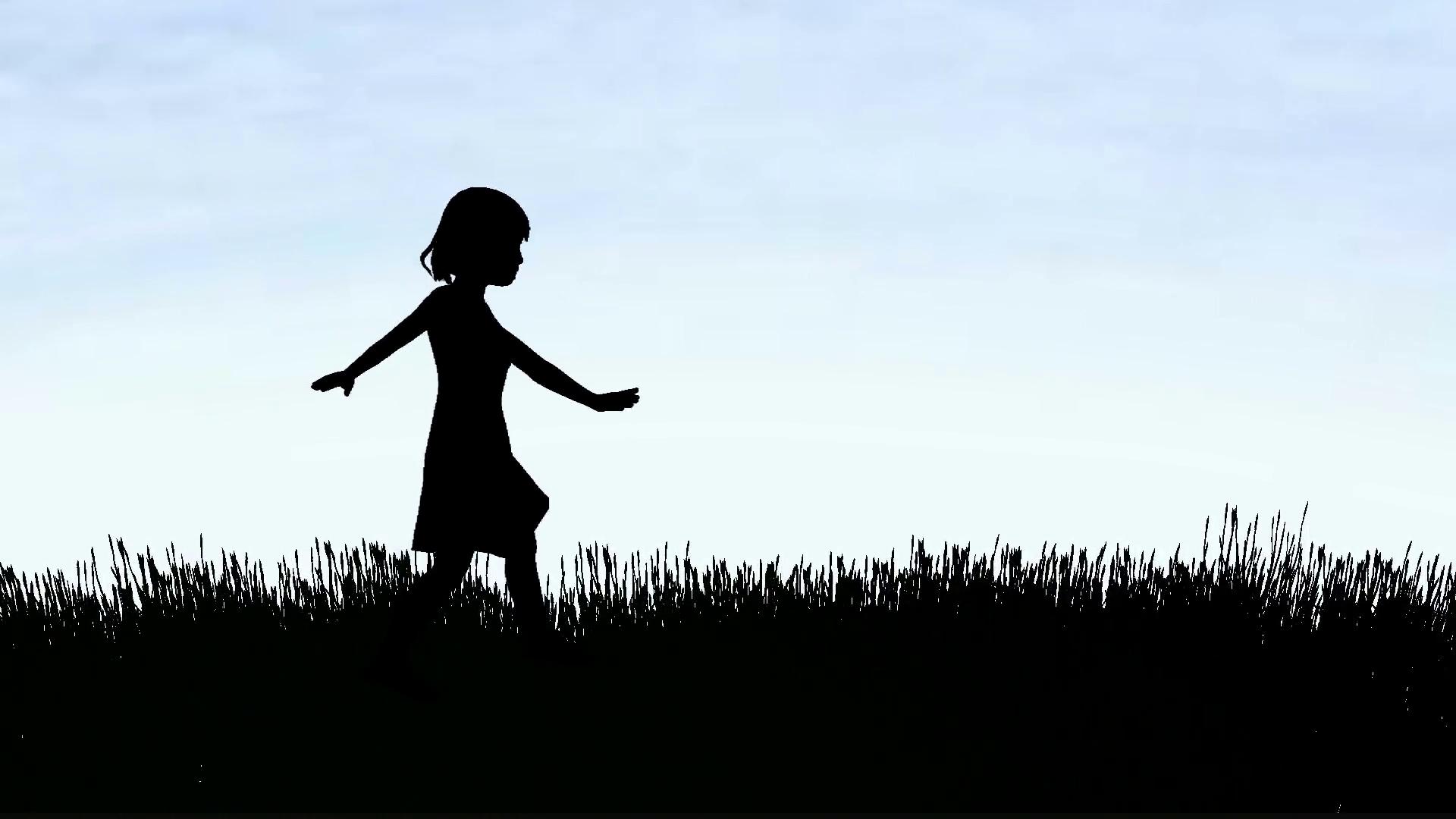 Silhouette Of A Little Girl Walking.