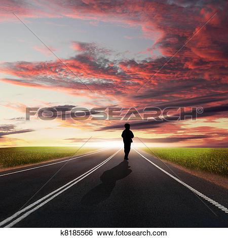 Drawings of Man walking away at dawn along road k8040184.