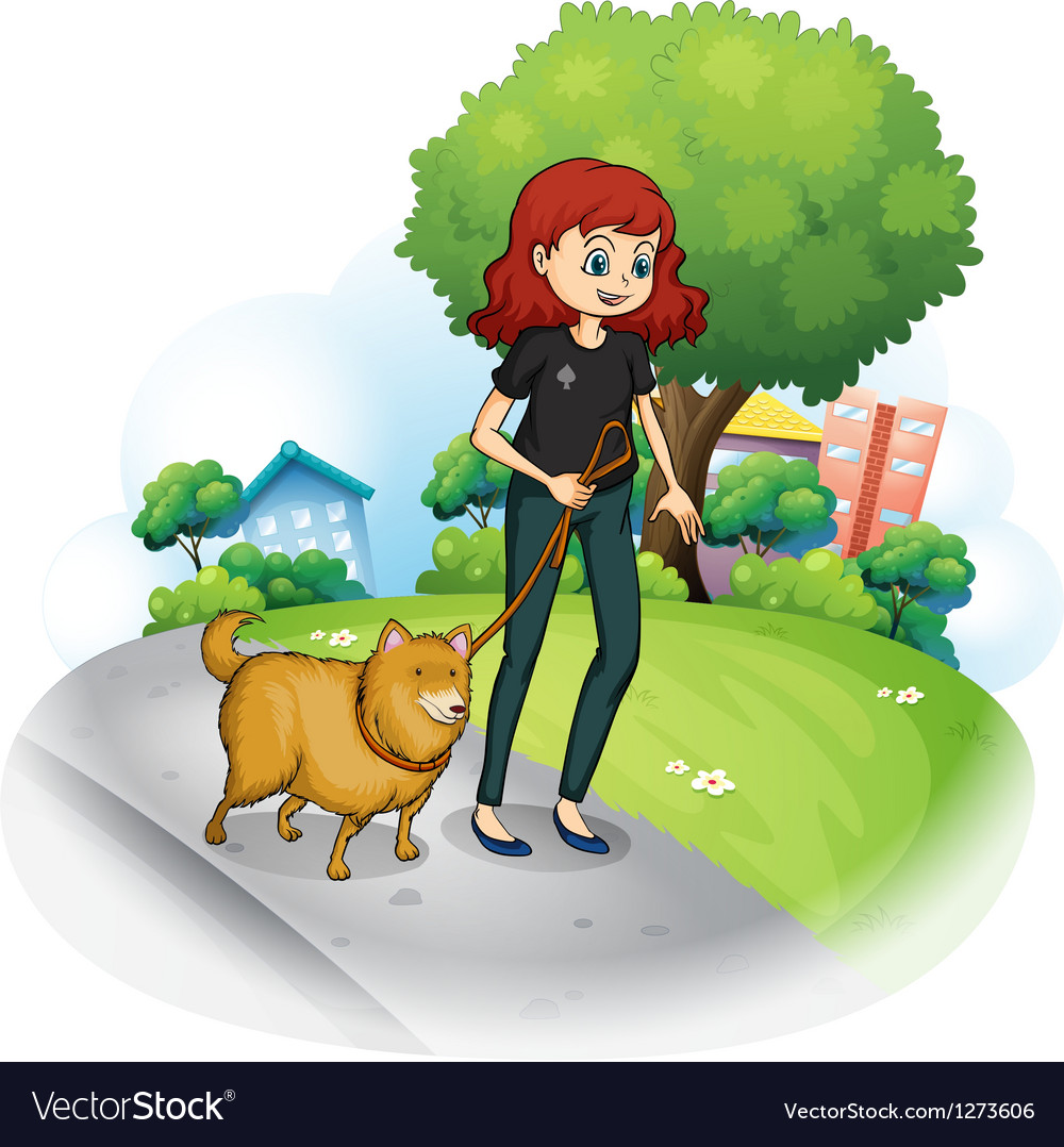 A girl with a dog walking along the street.