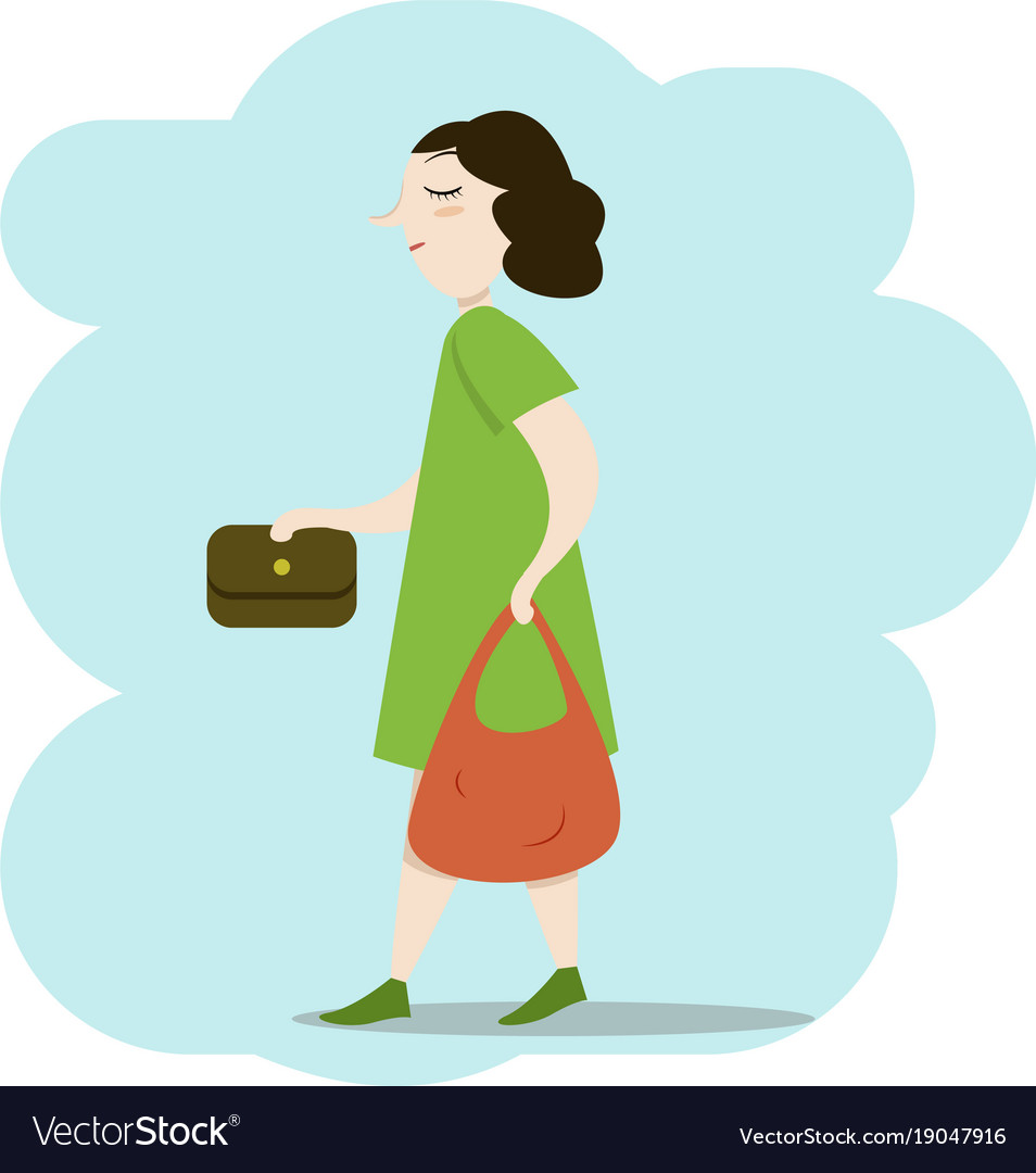 Woman walking down the street with bags.