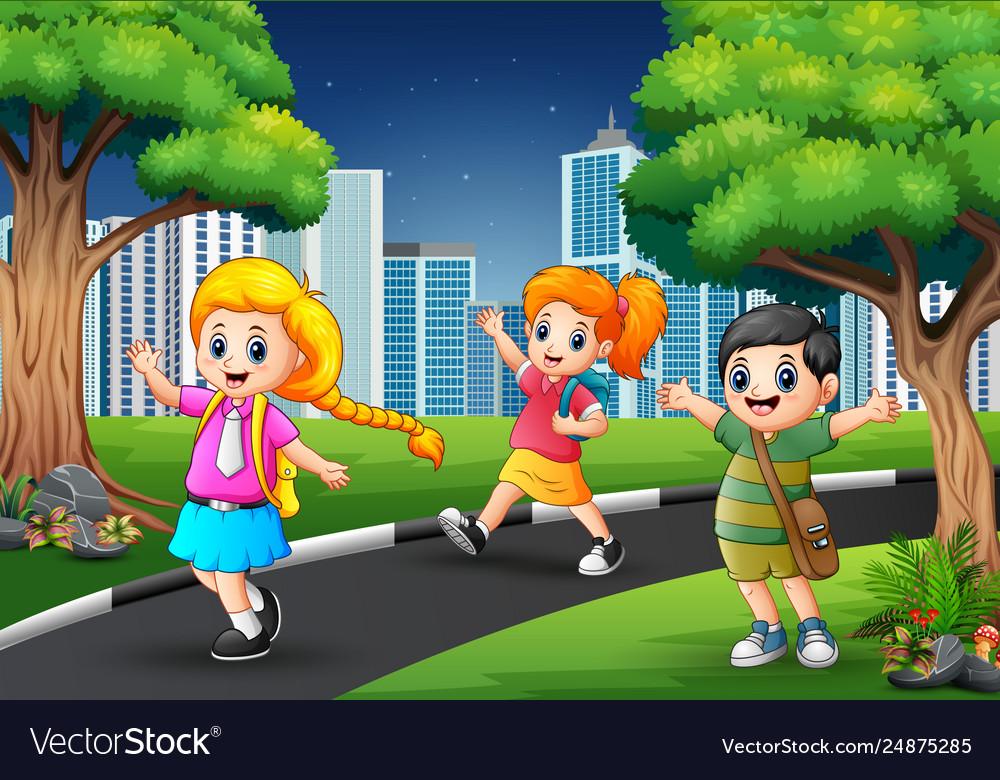 Happy school children walking on road to c.