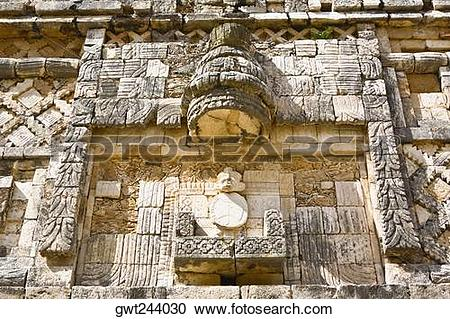 Stock Photography of Low angle view of a carved stone wall.