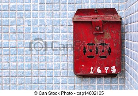 Stock Photography of Rusty Chinese postbox on a blue tiled wall.