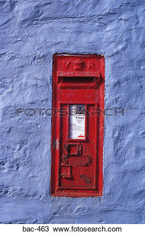 Stock Photo of Victorian Red Post Box in Blue Wall bac.
