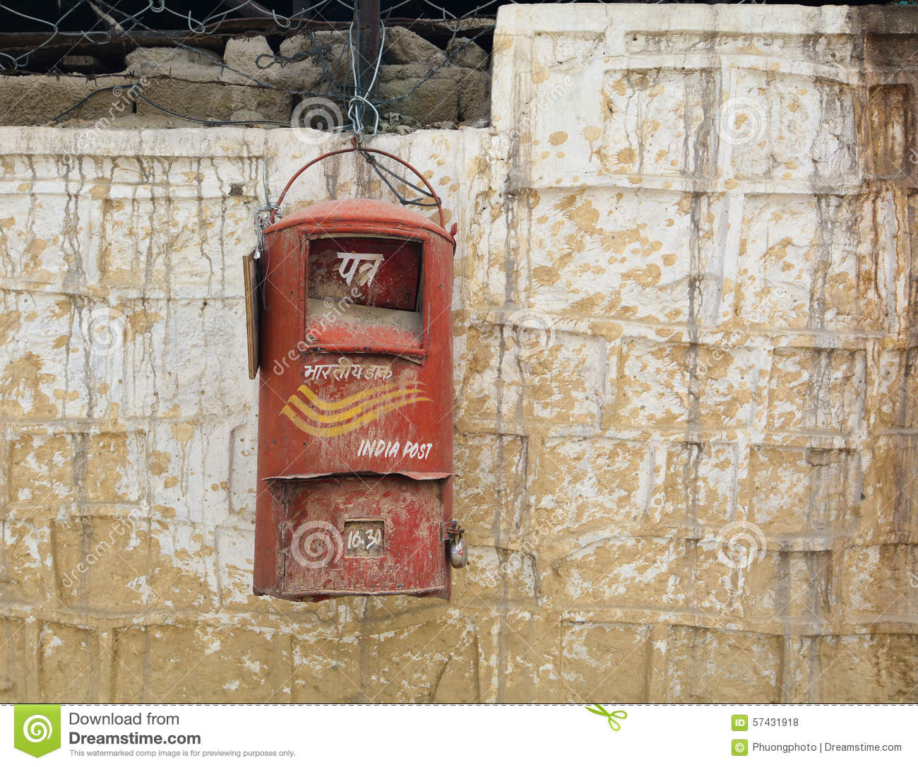 An Old Indian Post Box Hanging On A Wall Stock Photo.