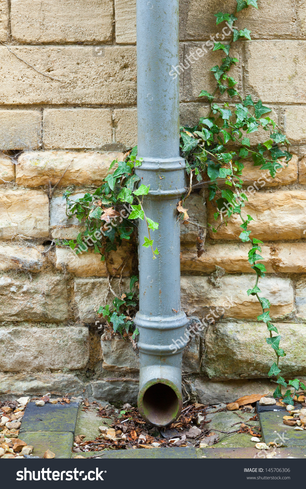 Closeup Cast Iron Drainpipe Attached Limestone Stock Photo.