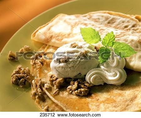 Stock Photo of Crepes with walnut ice cream, maple syrup and cream.