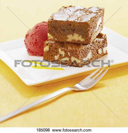 Pictures of Walnut brownie with a scoop of strawberry ice cream.
