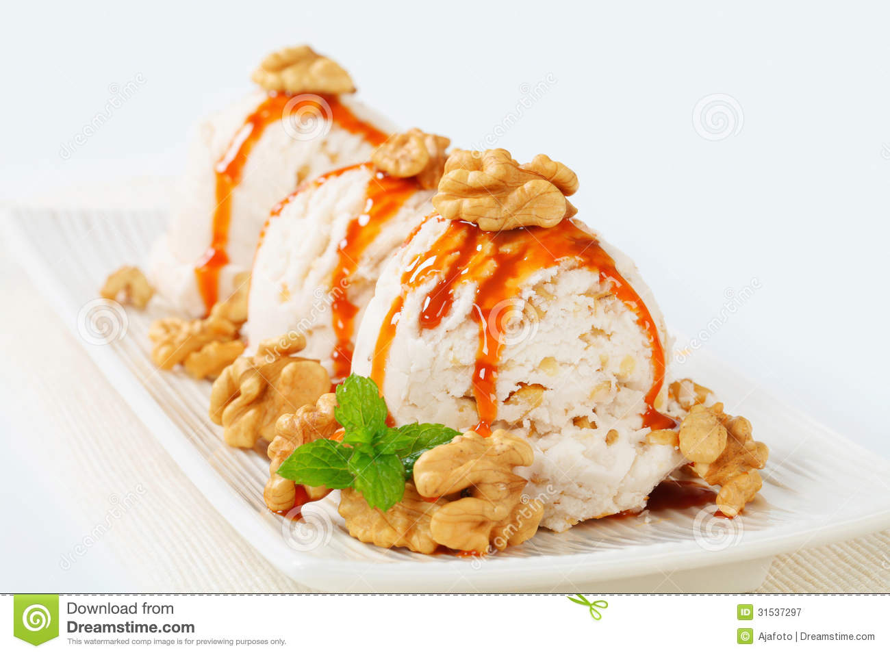 Walnut Ice Cream With Caramel Sauce Royalty Free Stock Photography.