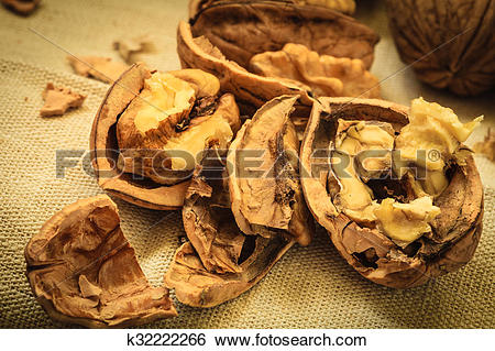 Stock Images of Walnut kernels on rustic table k32222266.