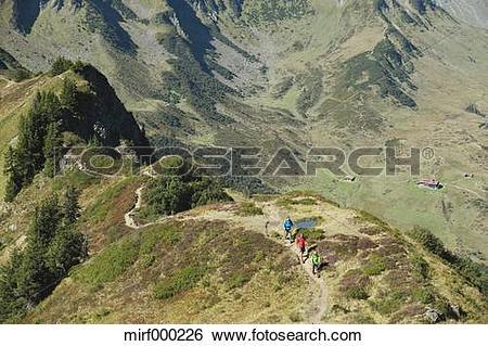 Stock Images of Austria, Kleinwalsertal, Group of people hiking on.