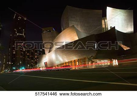 Stock Images of Buildings lit up at night in a city, Walt Disney.