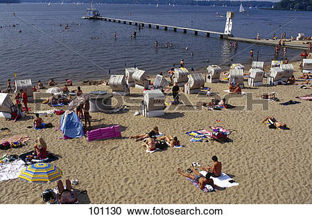 Stock Photography of High angle view of tourists sunbathing on.