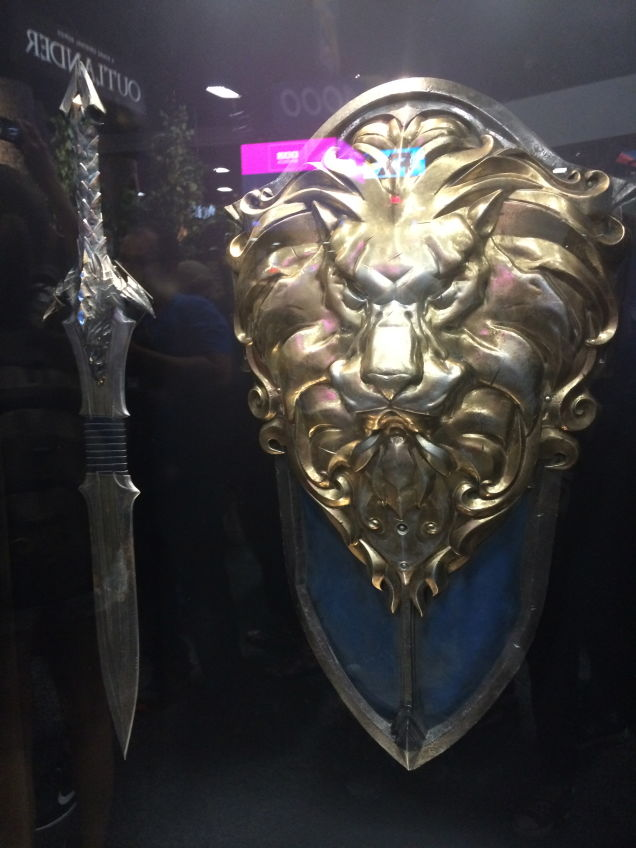 Behold The Warcraft Movie's Doomhammer, Lion Shield, And Dragon.