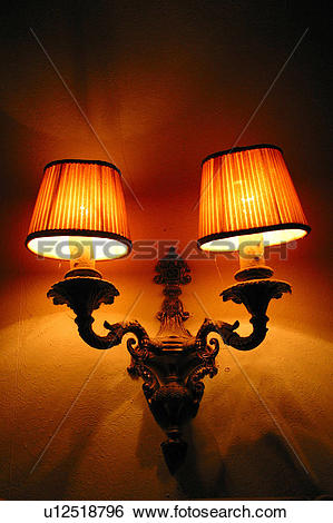 Stock Images of Warm Glow from Antique Wall Light u12518796.