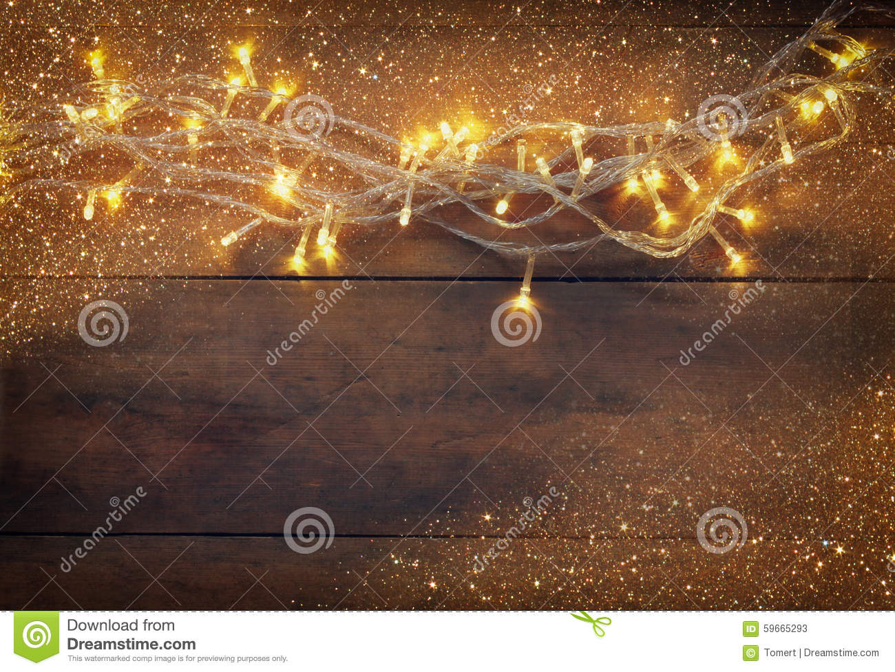 Christmas Warm Gold Garland Lights On Wooden Rustic Background.