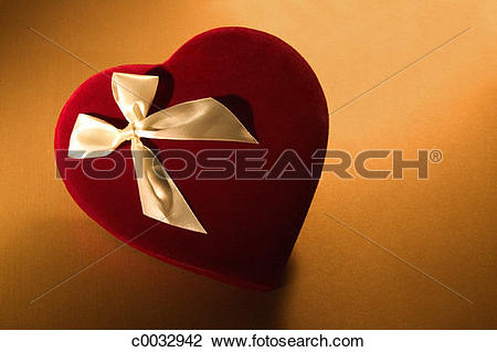 Stock Photo of A red box of Valentine's candy with a gold bow on.