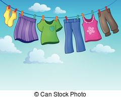 Clothes on washing line against blue sky and green grass..